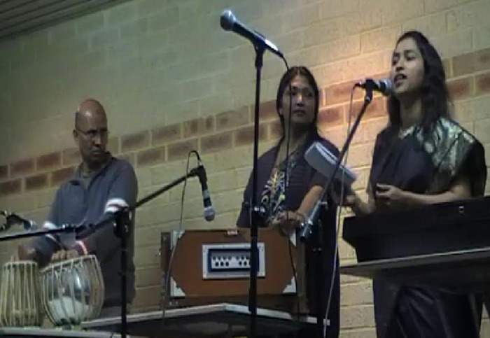 Nazrul (Batch-16) and his wife (Left) singing in a concert in Australia